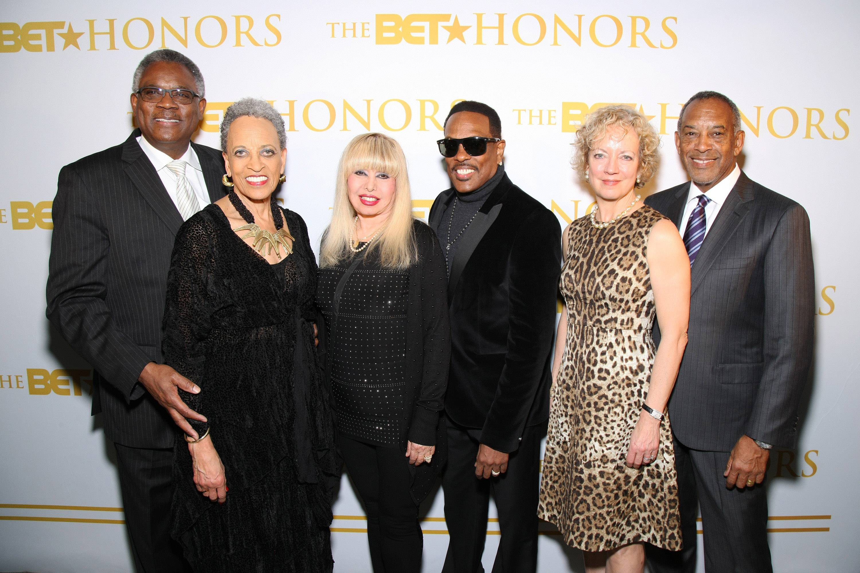 What Extraordinary Looks Like - Behind every luminary is their support system. Here, performer Charlie Wilson and honorees John W. ThompsonandDr. Johnnetta Betsch Cole are pictured with their spouses. (Photo: Bennett Raglin/BET/Getty Images for BET)