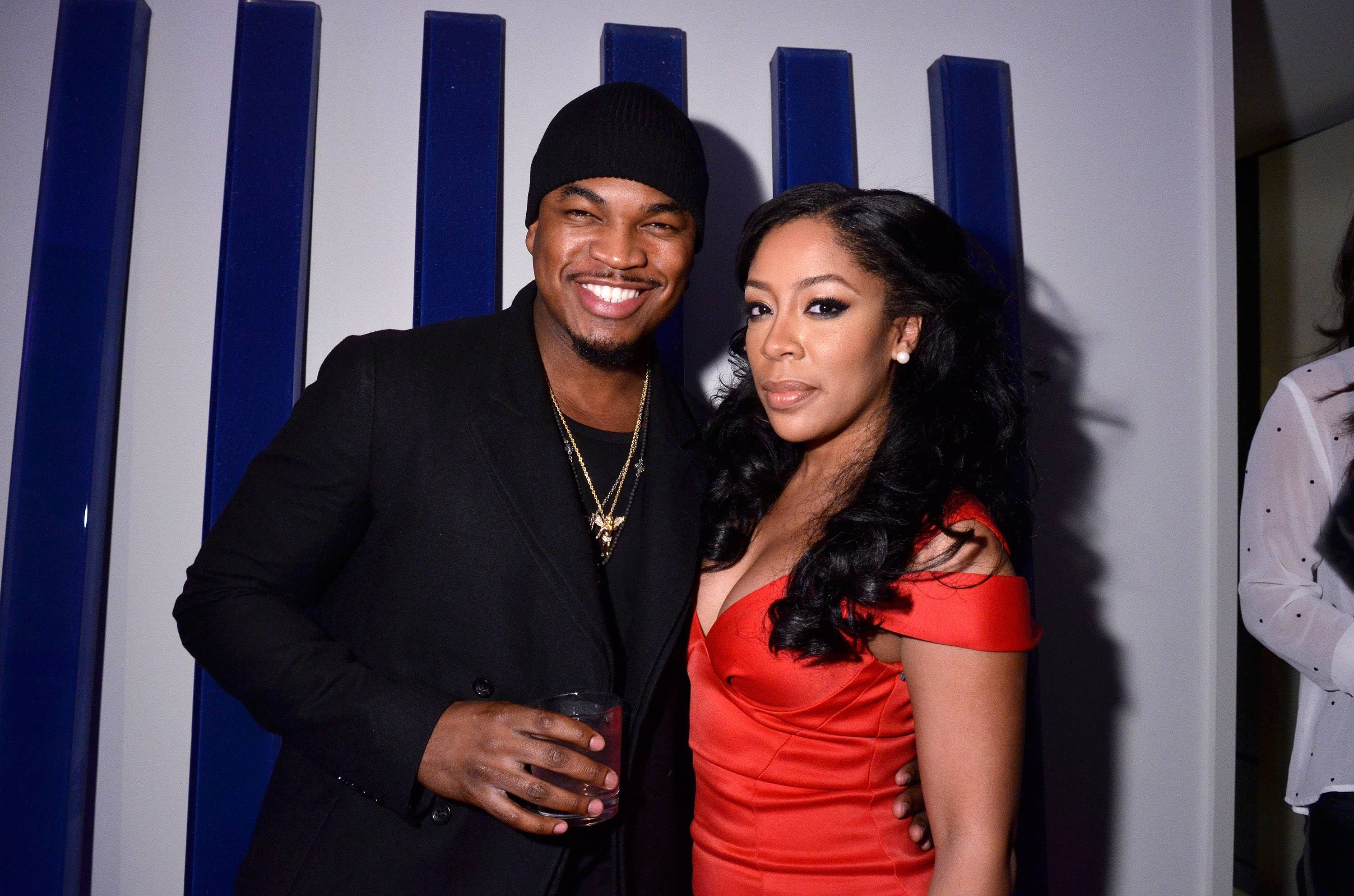 Music Matters - Taking a break from the stage, performers Ne-Yo and K.Michelle are sighted together.(Photo: Kris Connor/BET/Getty Images for BET)
