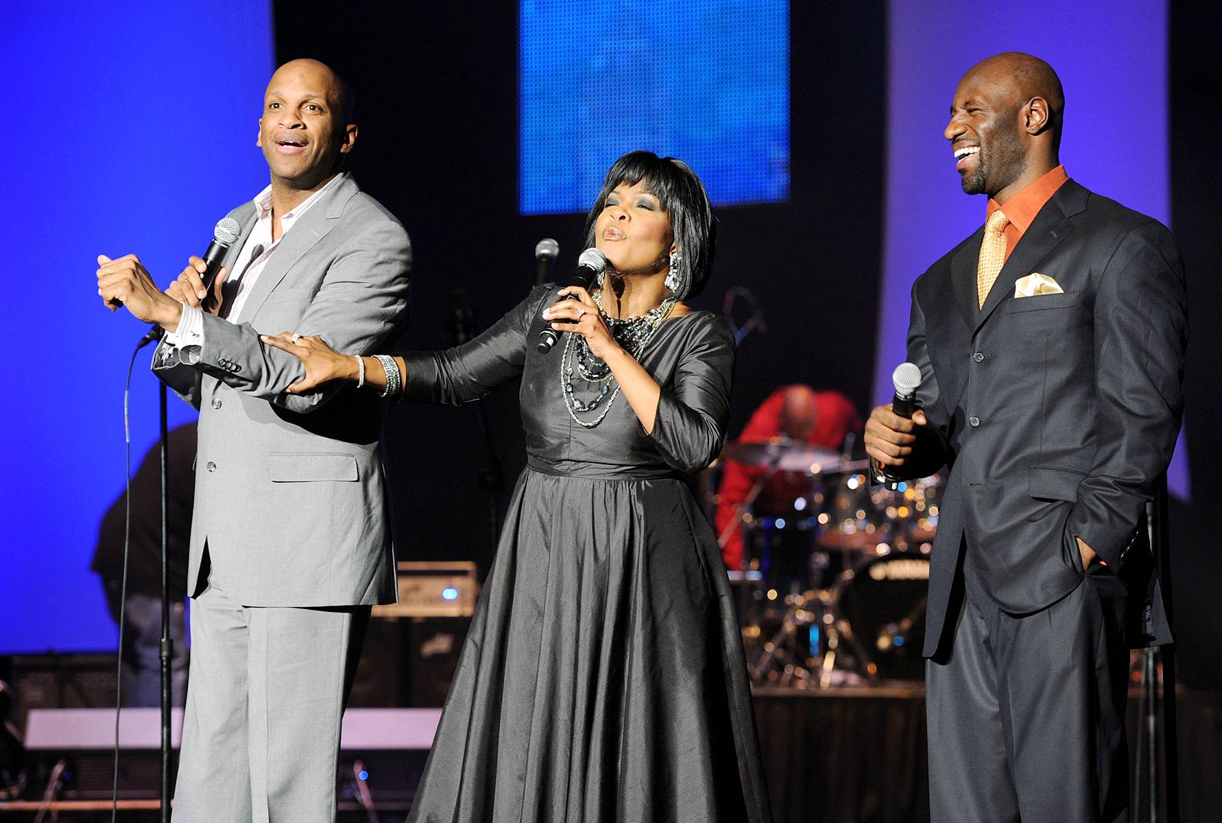 Lift Up the Name - Gospel artists Donnie McClurkin, Cece Winans and a guest hit the stage during the Super Bowl Gospel Celebration 2011 at Music Hall at Fair Park in Dallas. (Photo: Rick Diamond/Getty Images for Super Bowl Gospel Celebration 2011)