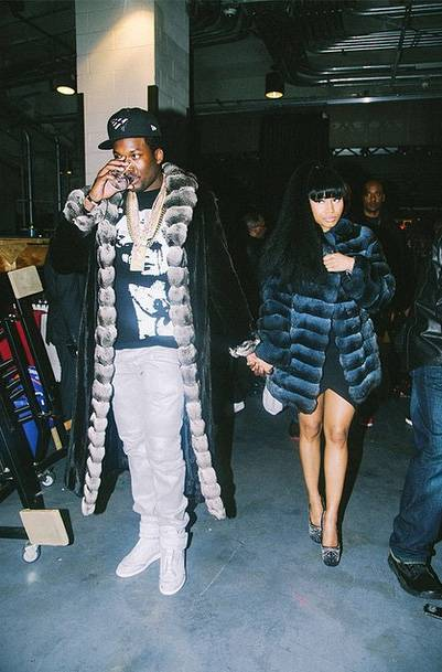 """No Pictures, Please - Rocking matching furs and holding hands, hip hop's newest partners in crime look pretty much picture perfect. Just ask Meek Mill, who posted this photo with the caption, """"I used 2 dream of this s**t.""""(Photo: Meek Mill via Instagram)"""