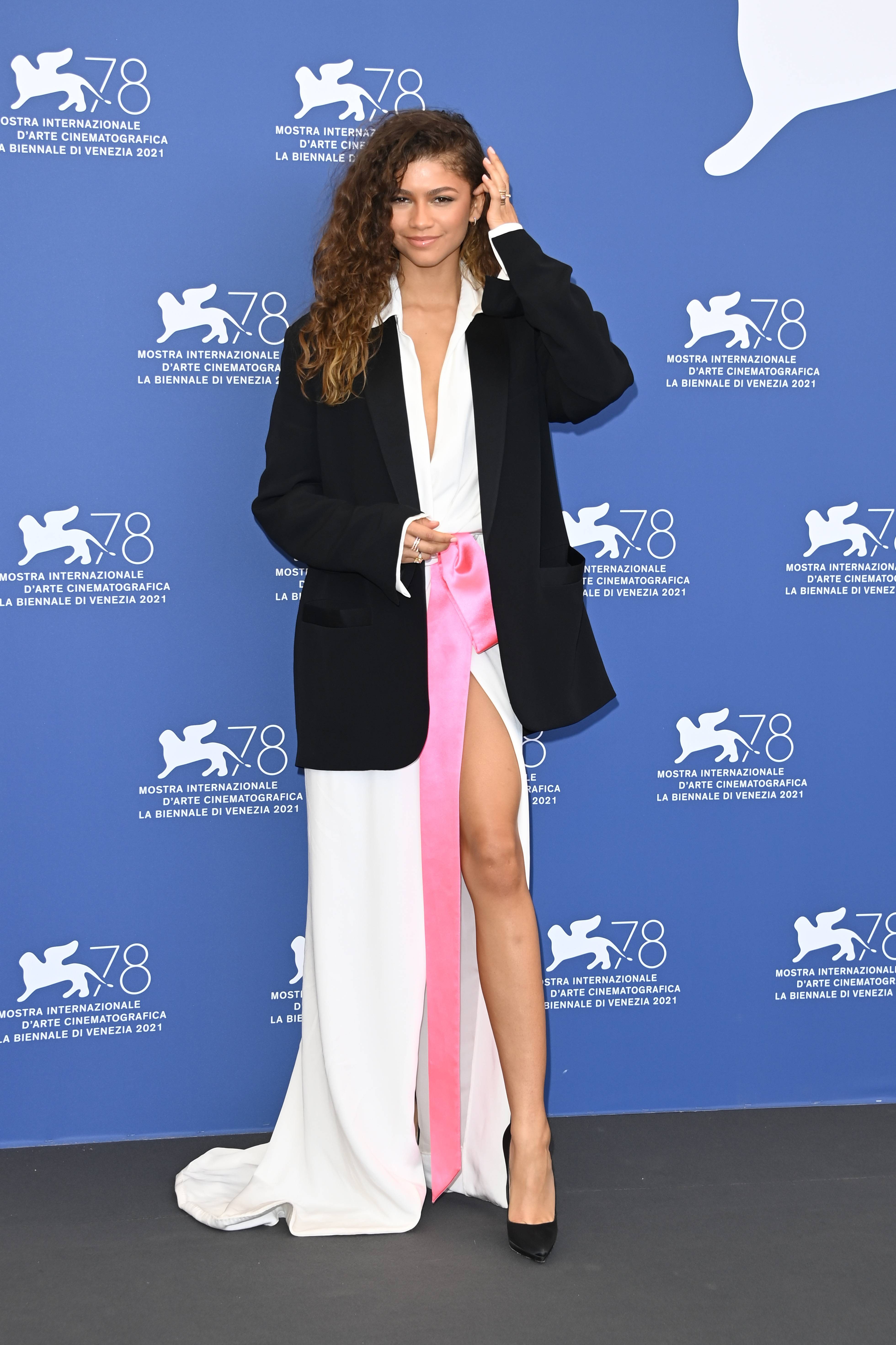 From Italy with love - Actress Zendaya, 25, steps out in a Valentino ensemble for the Venice Film Festival wearing a blazer with a split open skirt and loose wild curls. The decorated actress stunned in a Valentino Couture look that only she can pull off! The actress just celebrated her 25th birthday. Life is ahead of her, beautifully so, and we love to see it. (Getty Image)
