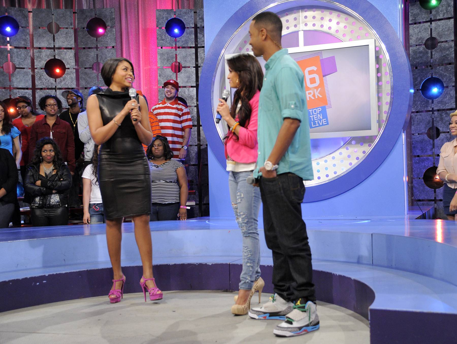"""Movie Star - Taraji P. Henson wants people to stop labeling movies as """"black movies"""" and just call them movies, with Rocsi Diaz and Terrence J at 106 & Park, April 17, 2012. (Photo: John Ricard/BET)"""
