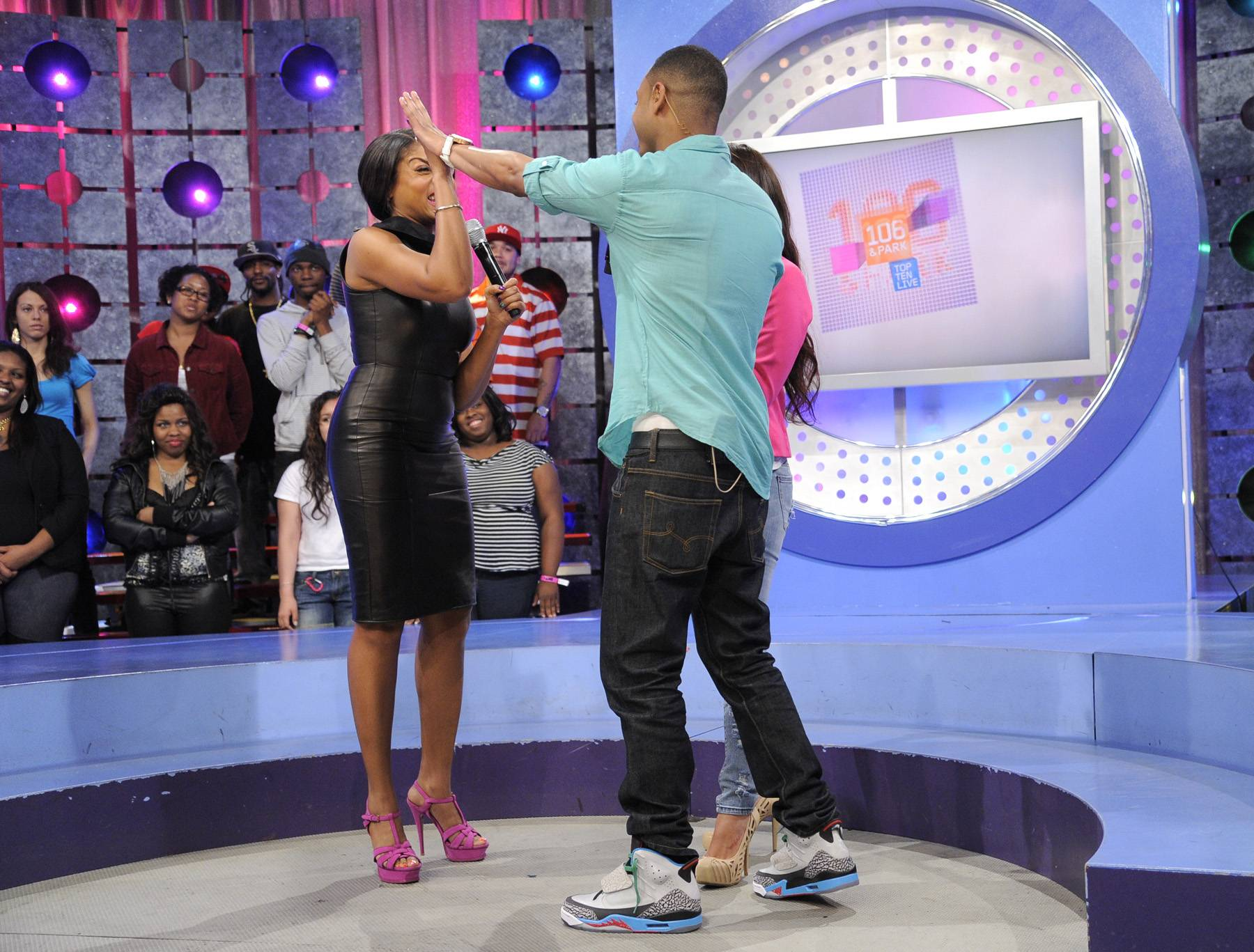 """High Five - Taraji P. Henson wants people to stop labeling movies as """"black movies"""" and just call them movies, with Rocsi Diaz and Terrence J at 106 & Park, April 17, 2012. (Photo: John Ricard/BET)"""