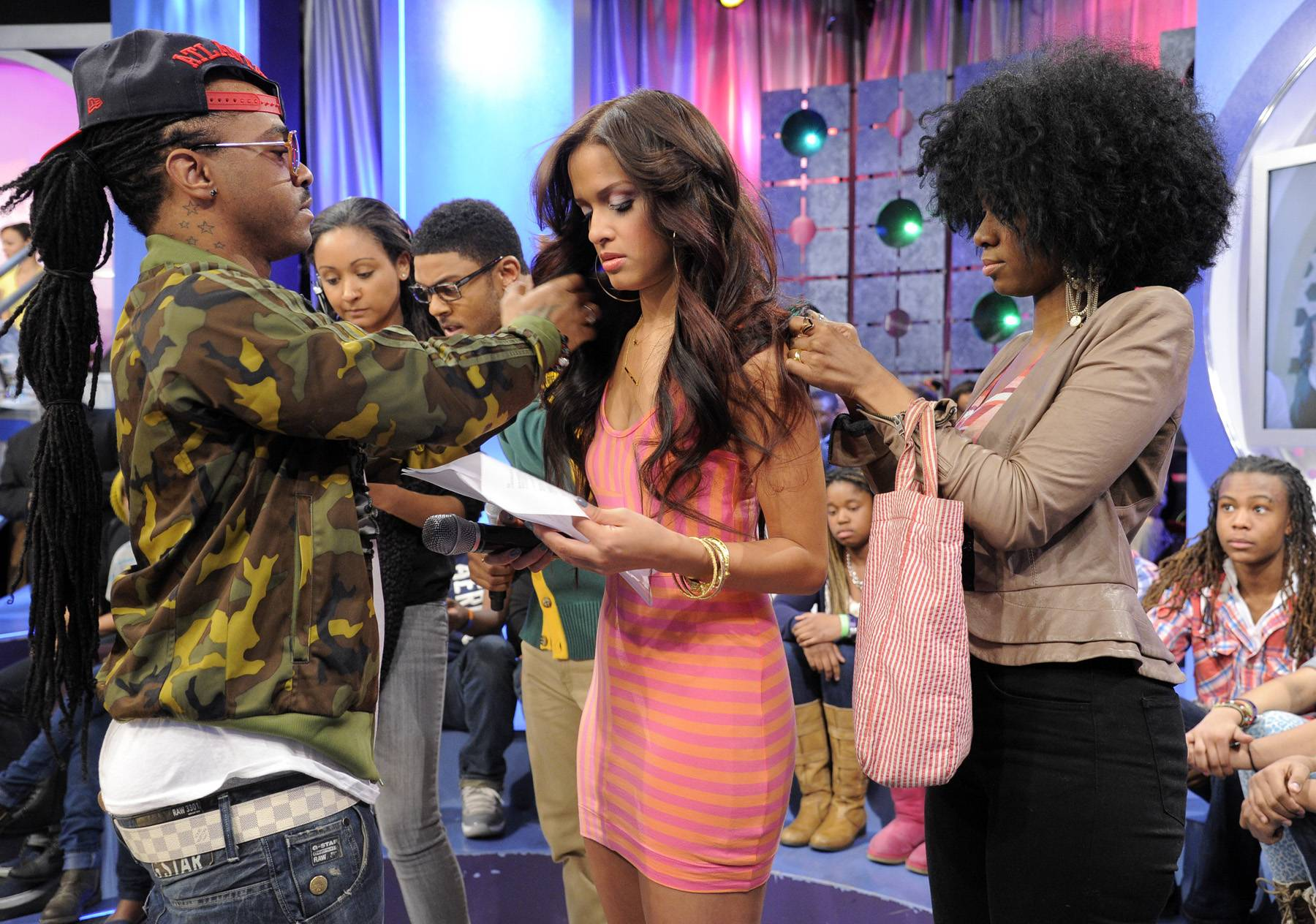 Just A Touch - Rocsi Diaz get touch ups by Q and goes over script during a commercial break at 106 & Park, April 12, 2012. (Photo: John Ricard / BET)