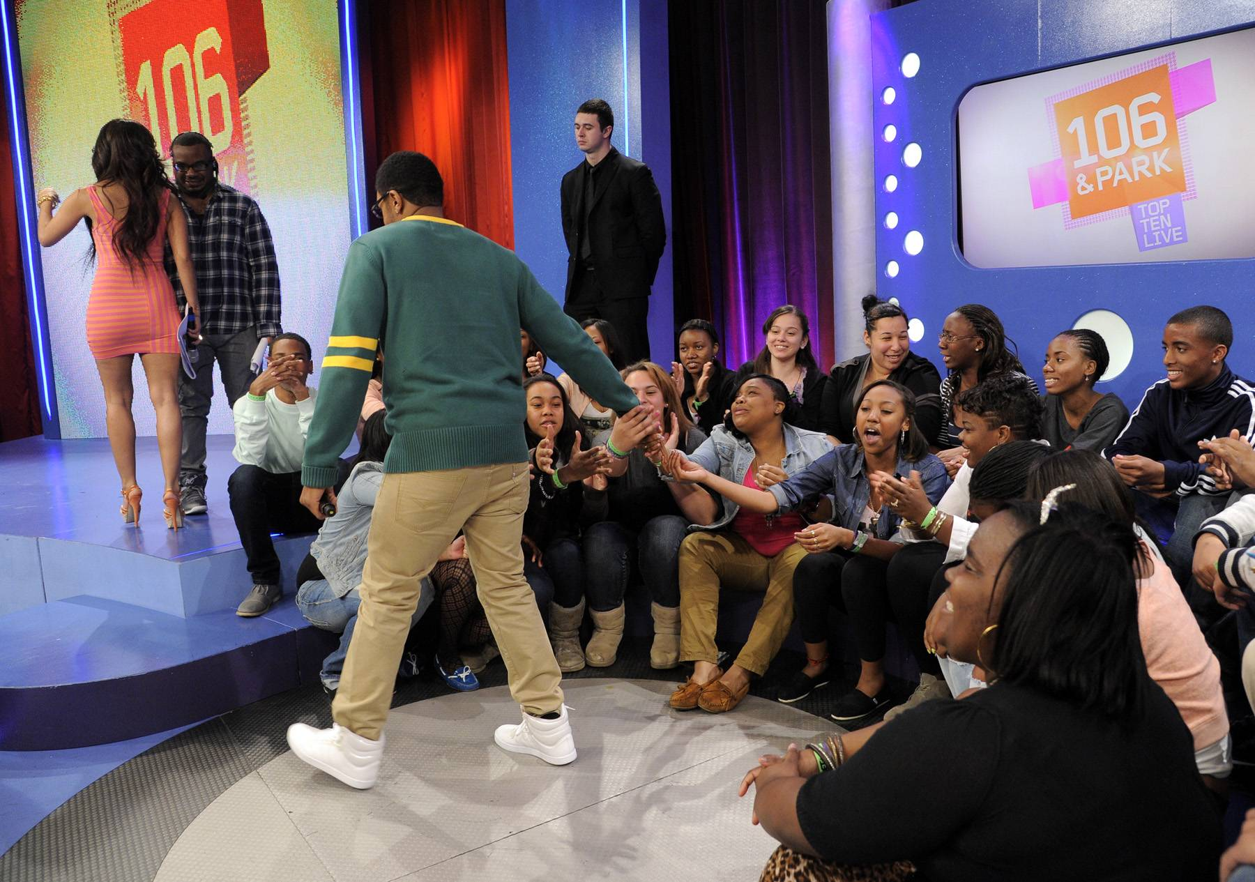 Exiting For a Moment - Pooch Hall acknowledges fans at 106 & Park, April 12, 2012. (Photo: John Ricard / BET)