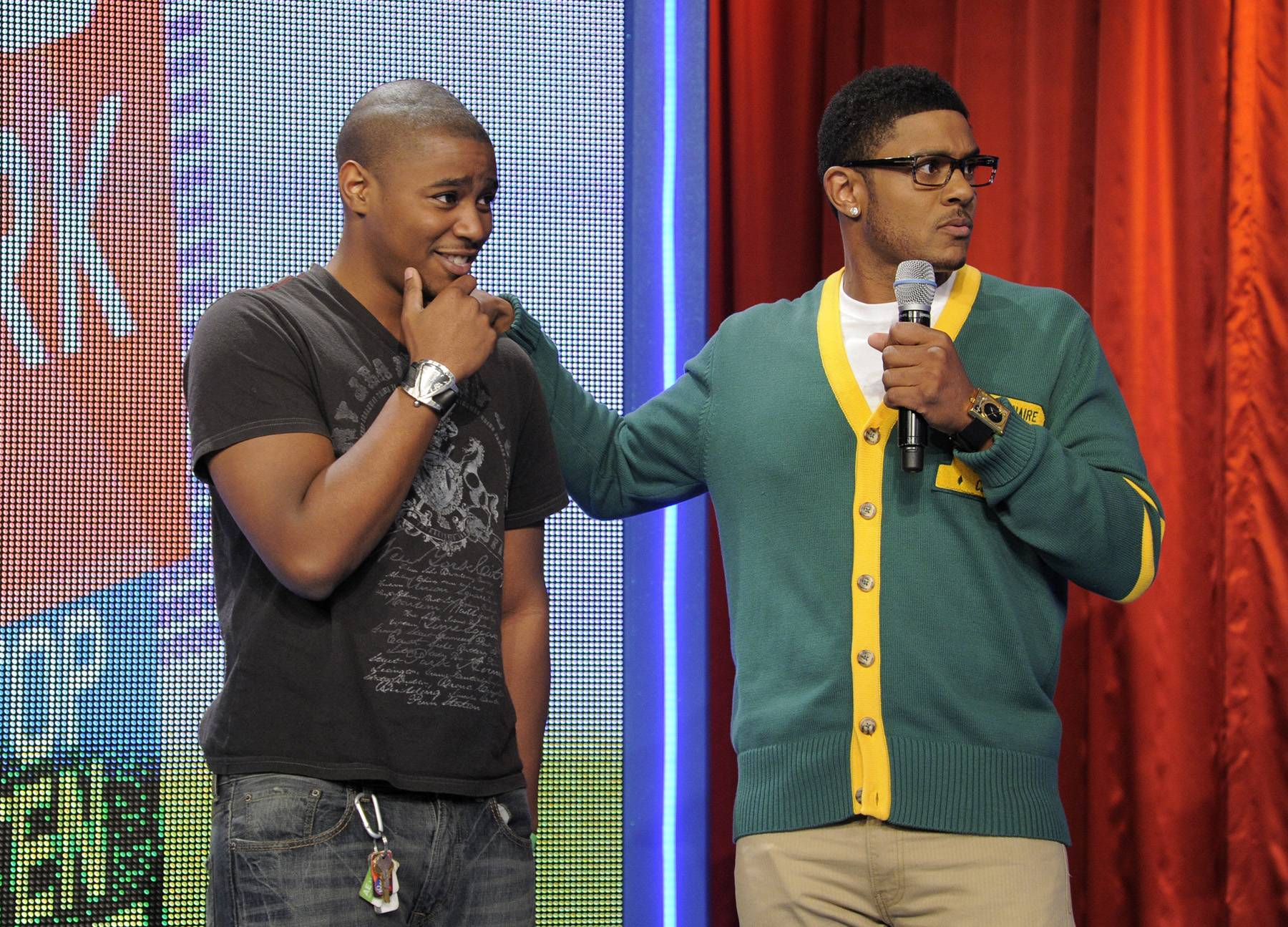 Perplexed By The Fact? - Rocsi Diaz and Pooch Hall does random facts with audience members at 106 & Park, April 12, 2012.(Photo: John Ricard / BET)
