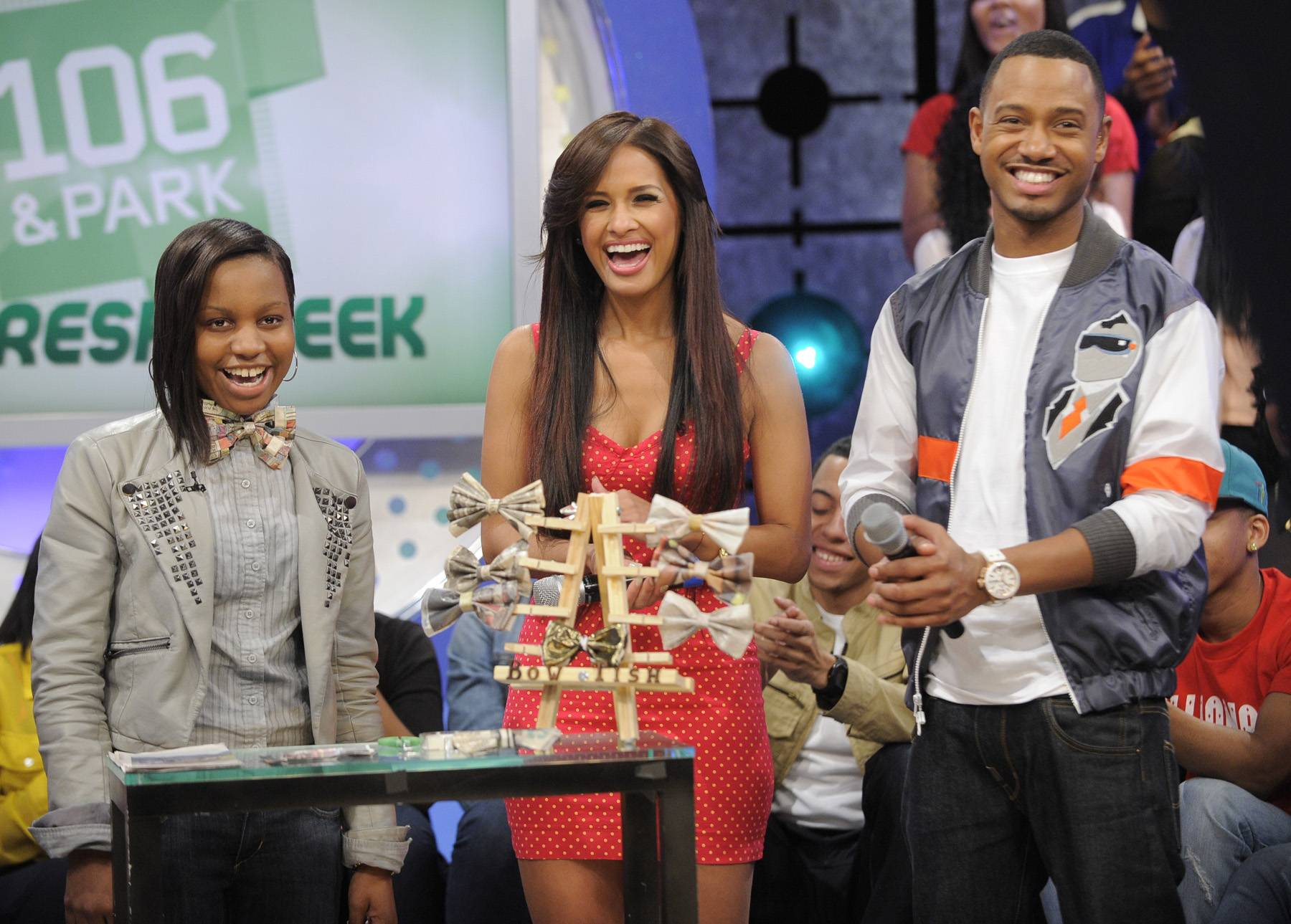 """Bow Tie Fun - Tisha Johnson shows Rocsi Diaz and Terrence J bow ties she makes from recycled materials during """"Get Fresh Week"""" at 106 & Park, May 3, 2012. (Photo by: John Ricard / BET)"""