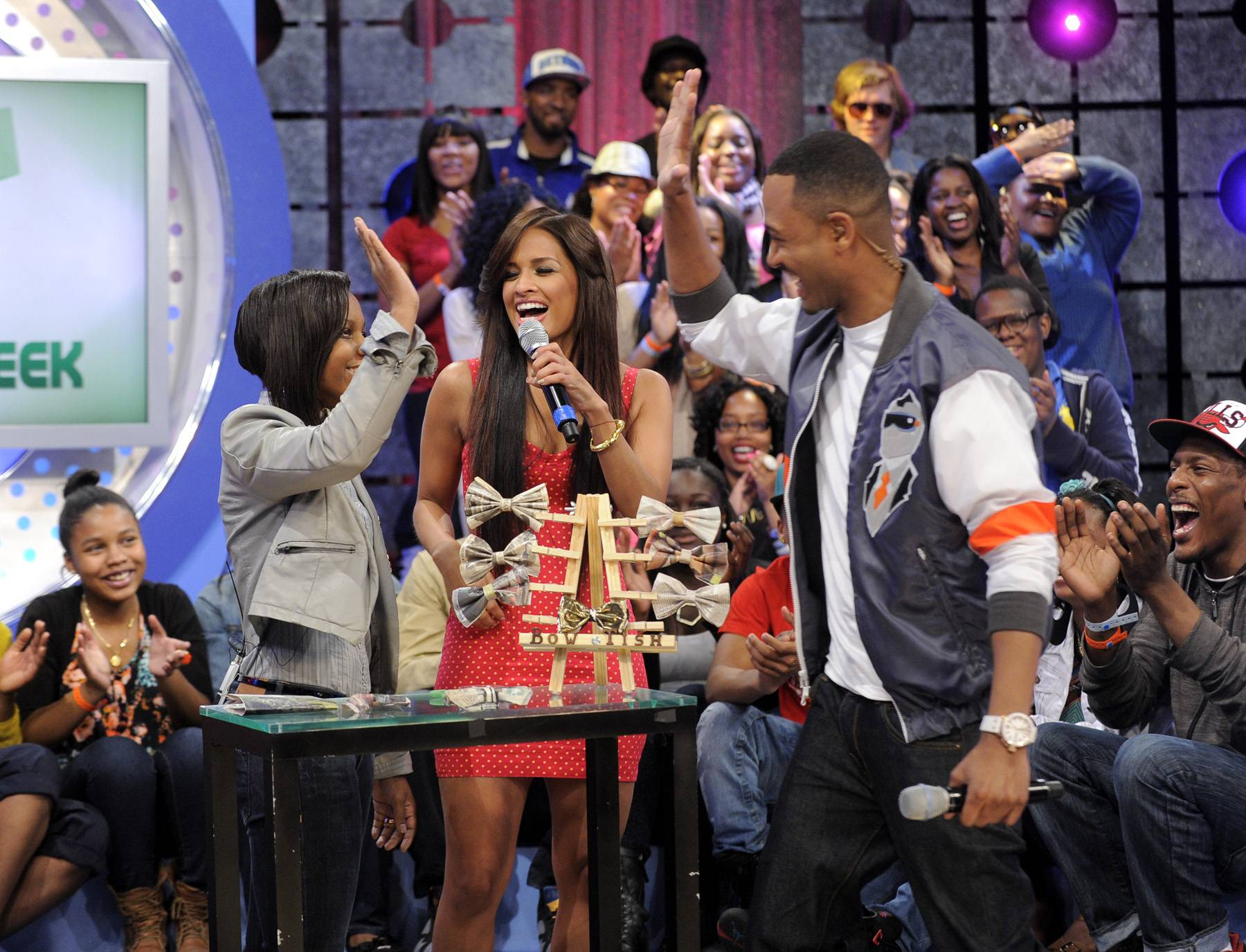 High Five For Bow Ties - Tisha Johnson receives a high five from Rocsi Diaz and Terrence J and is told she would make a great field correspondent for the show at 106 & Park, May 3, 2012. (Photo by: John Ricard / BET)