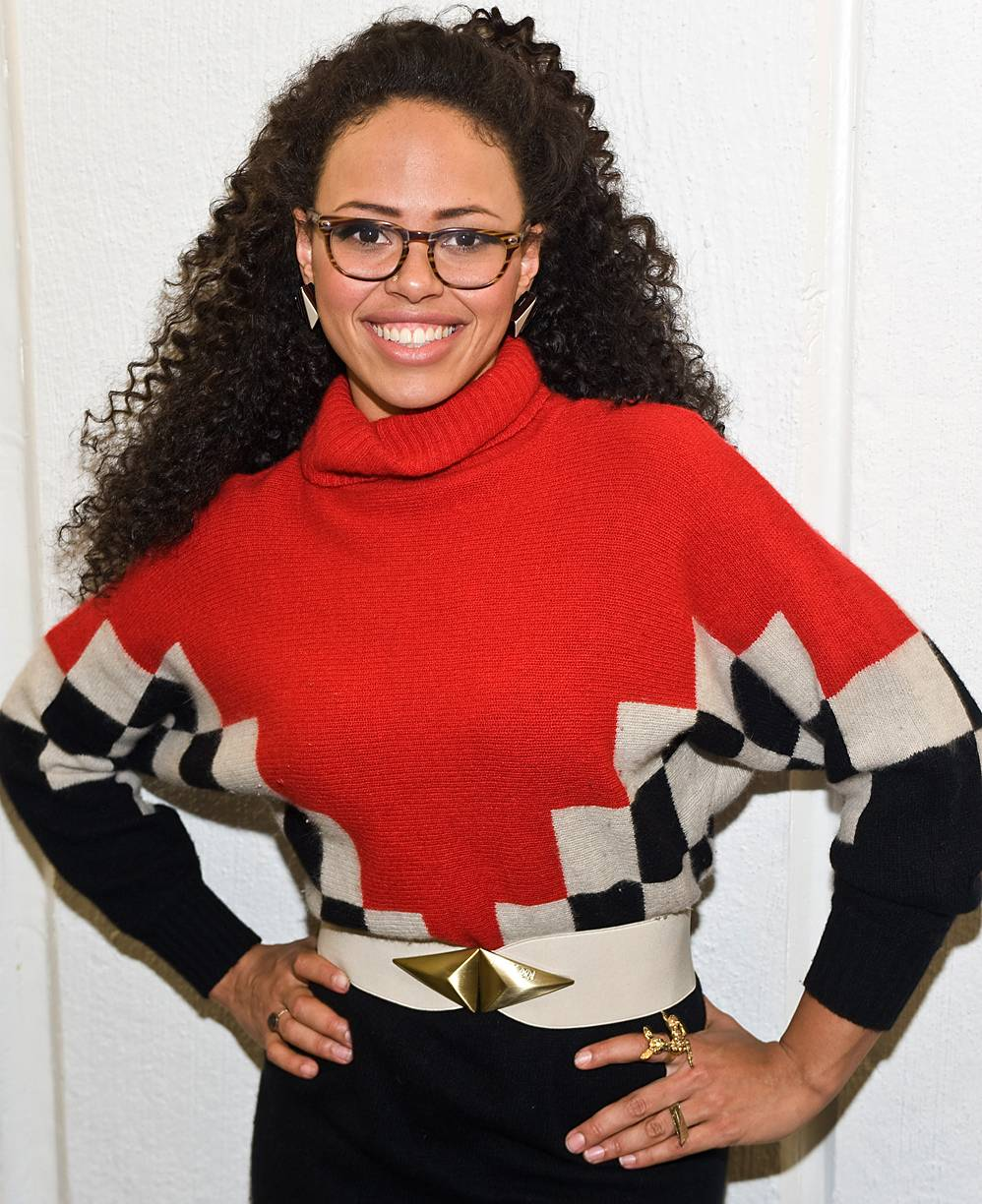 Huxtable Inspired\r - Elle gives us Denise Huxtable chic in her oversized sweater, glasses and belt.\r(Photo: Timothy Hiatt/Getty Images)
