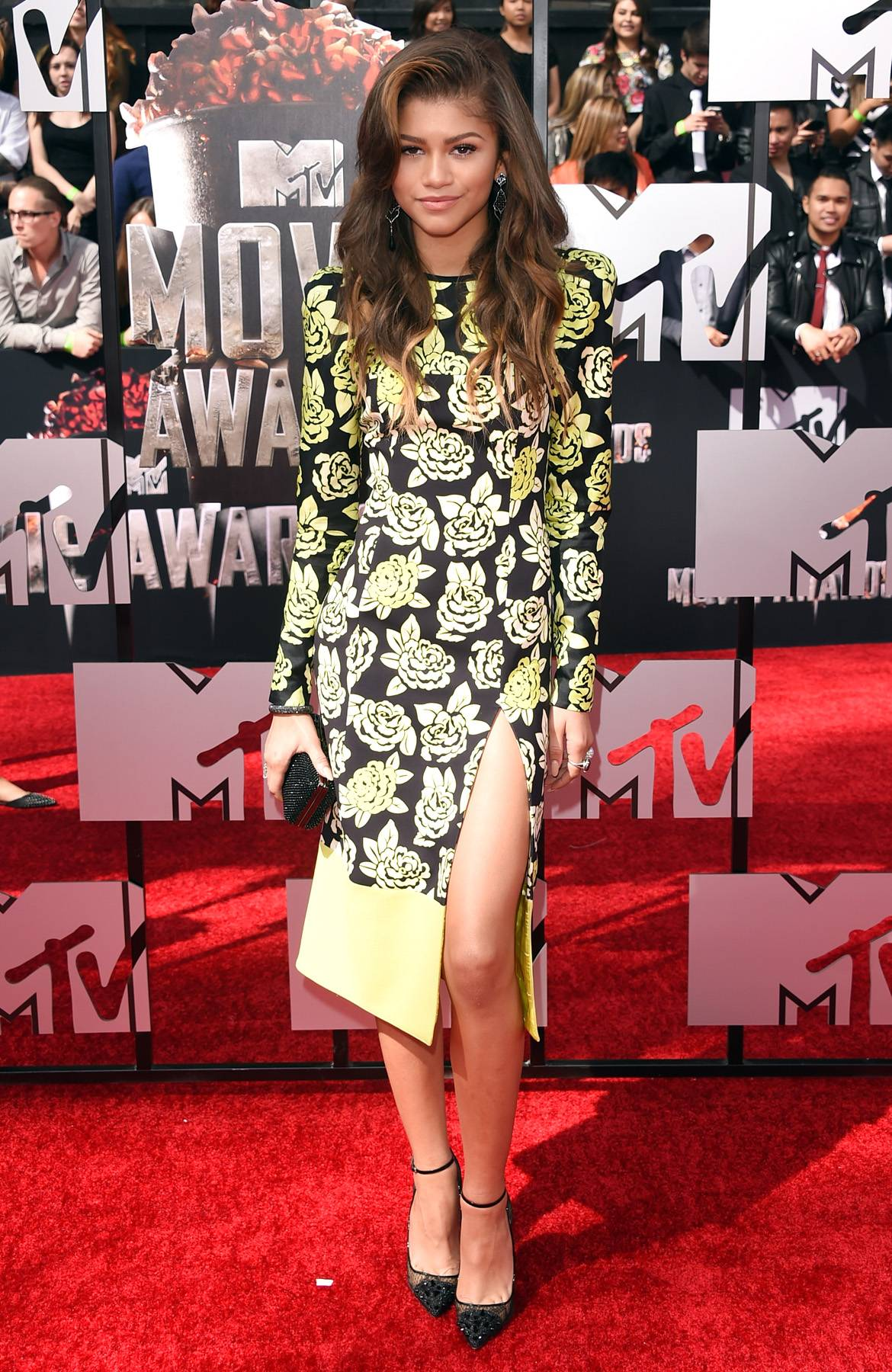 Rosy Disposition - The actress is all grown up in a rose-printed Emanuel Ungaro gown with racy thigh-high slit, accessorizing simply with a black oval clutch and ankle-strap pumps.  (Photo: Jason Merritt/Getty Images for MTV)