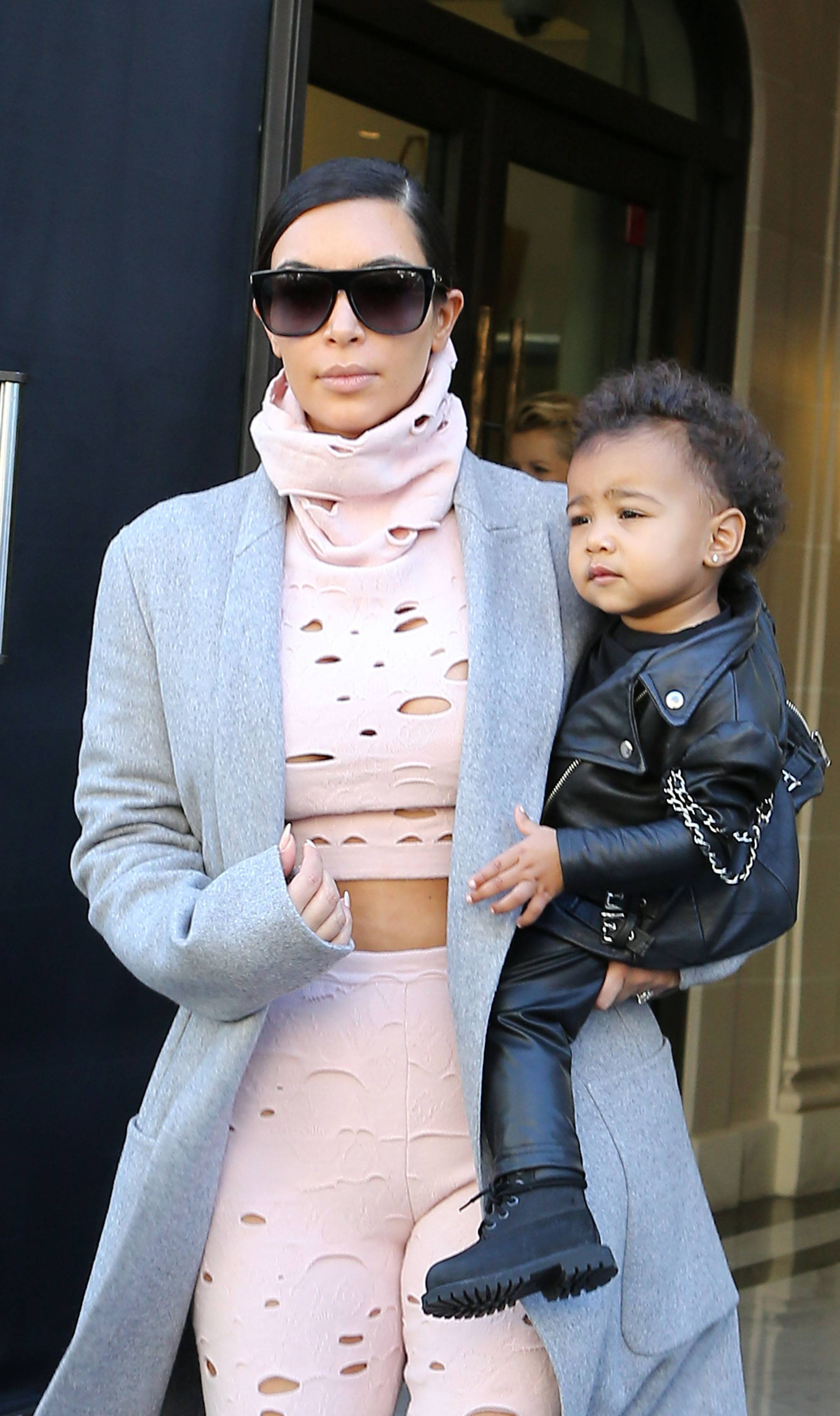 Kim Kardashian and North West at Paris Fashion Week - Kim Kardashian was spotted leaving her hotel in Paris with her daughter,North West, Wednesday. Kim, North, Kanye and Kris Jenner had been attending Paris Fashion Week for the past few days but North West was the real star of the show. She's just over one and is already a little fashionista. How cute is she in her baby biker jacket (pictured above)? Yaaaassssss!   (Photo: KCS Presse/Splash News)