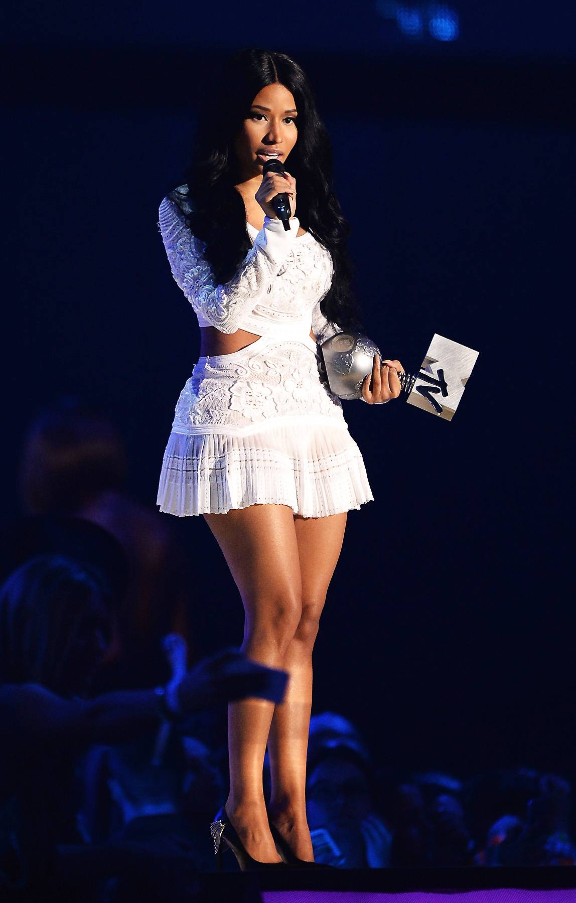 White Hot - Nicki wore another ivory mini, this one by Roberto Cavalli. It was a custom creation that featured a sheer pleated skirt, floral appliqu?s and cutouts at the waist. (Photo: Samir Hussein/Getty Images for MTV)