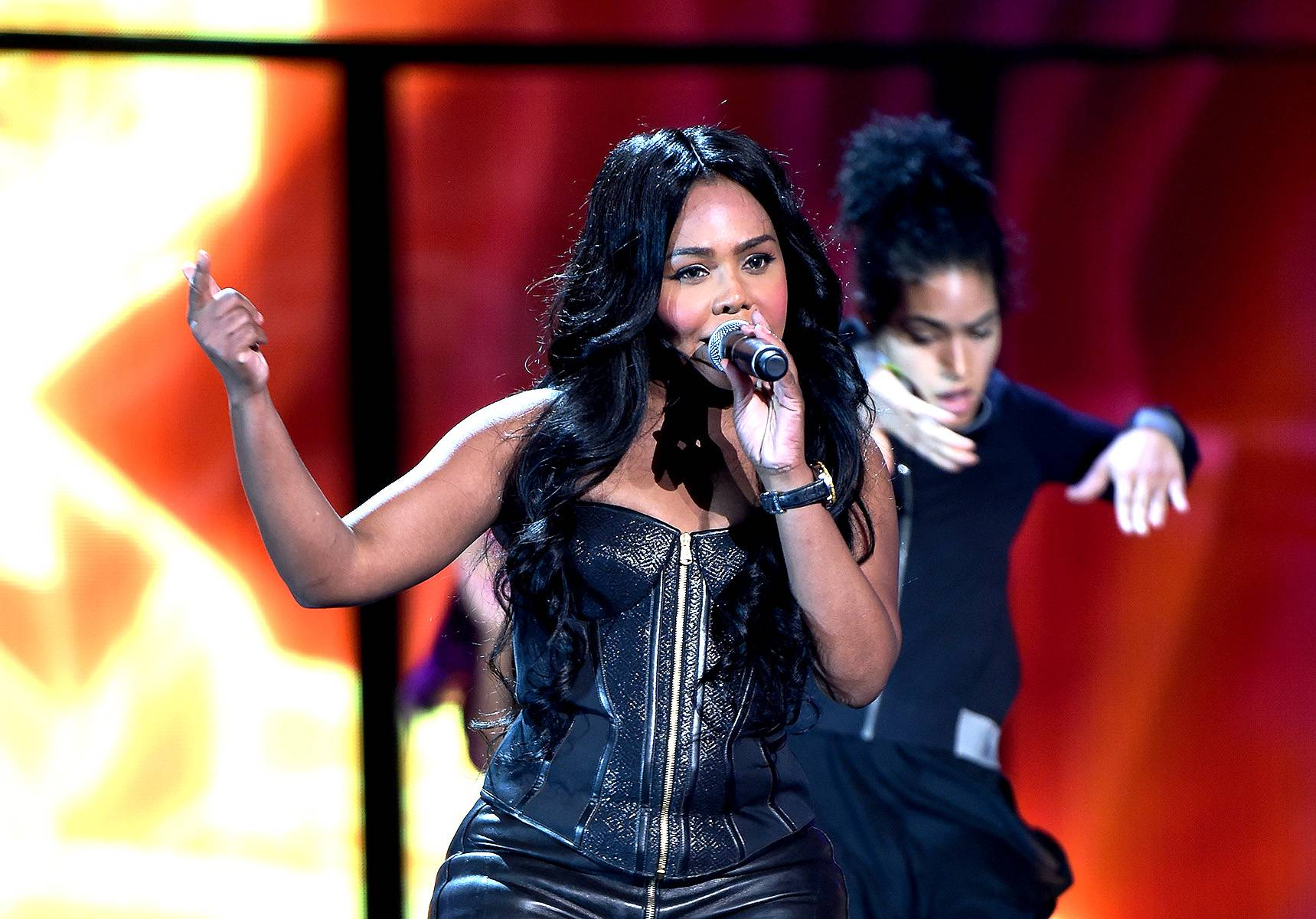 Lil' Kim the Queen B, So You Best Take Heed - Pint-sized diva Lil' Kim rocks the stage in rehearsals.(Photo: Ethan Miller/Getty Images for BET)