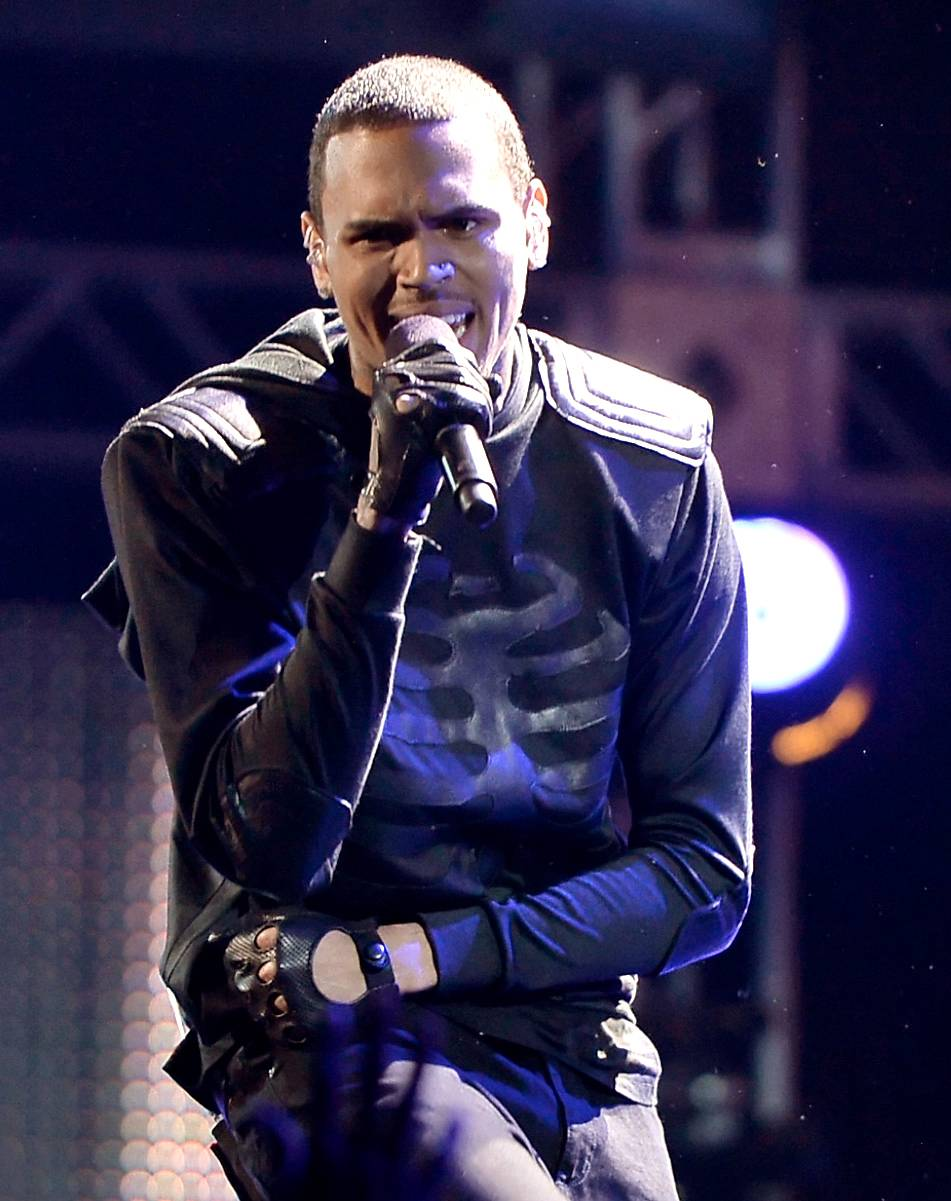 """Chris Brown - Chris Brownmay have hosted one of the most famous love triangles to date with his yo-yoing fromRihannatoKarrueche Tran. Breezy admitted that he was """"in love with two women"""" in a2012 videoand has played his part in letting the drama unfold on social media.(Photo: Kevin Winter/Getty Images for BET)"""