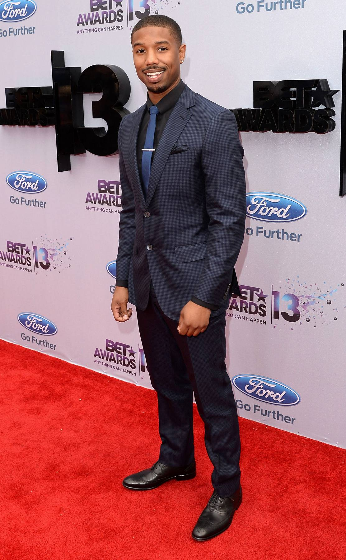 Dapper - Fruitvale star Michael B. Jordan knows how to wear a suit. The young actor steps out in navy and black.   (Photo: Jason Merritt/BET/Getty Images for BET)