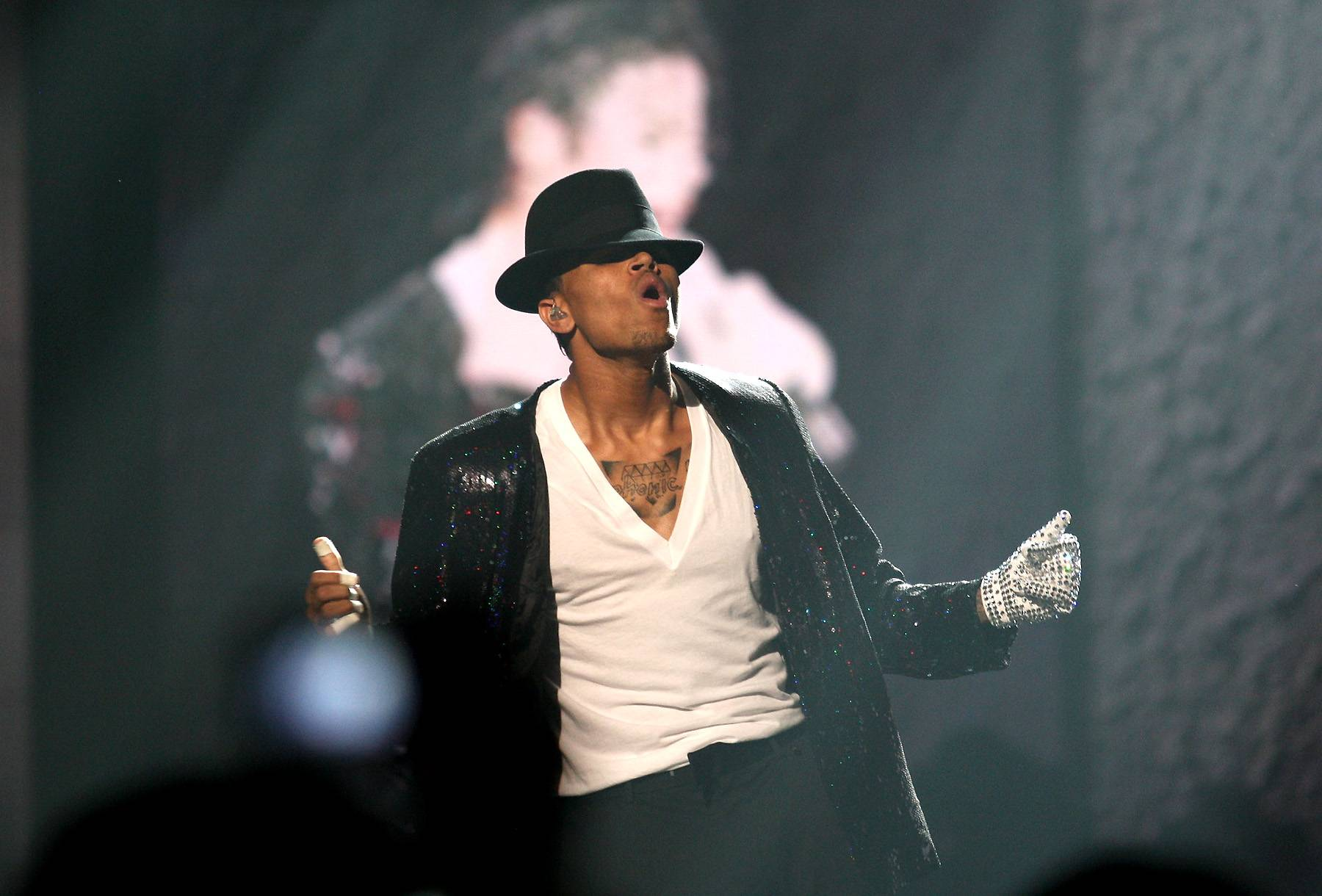 """Chris Brown - It ain't hard to tell that MJ's moves have inspired Chris Brown. Breezy has been vocal about his adoration for the late great singer since day one. But the """"Loyal"""" singer got to officially show his respect for the King of Pop a year after MJ's death when he performed an emotional tribute at the BET Awards. Donning a replica MJ hat and his iconic glove, Breezy performed a medley of hits –– singing and dancing his way through songs like """"The Way You Make Me Feel"""" and """"Man in the Mirror.""""Breezy continued to show his dedication when he premiered his """"Fine China"""" video in 2013.(Photo: Frederick M. Brown/Getty Images)"""
