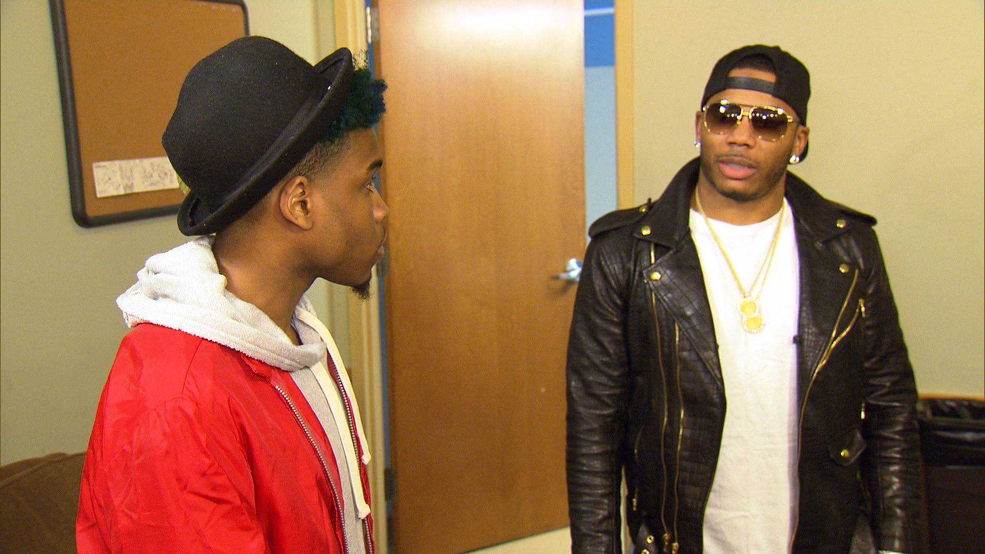 Big Leagues - Nelly gives Lil' Shawn and Shad of JGE Retro some encouragement backstage. (Photo: BET)
