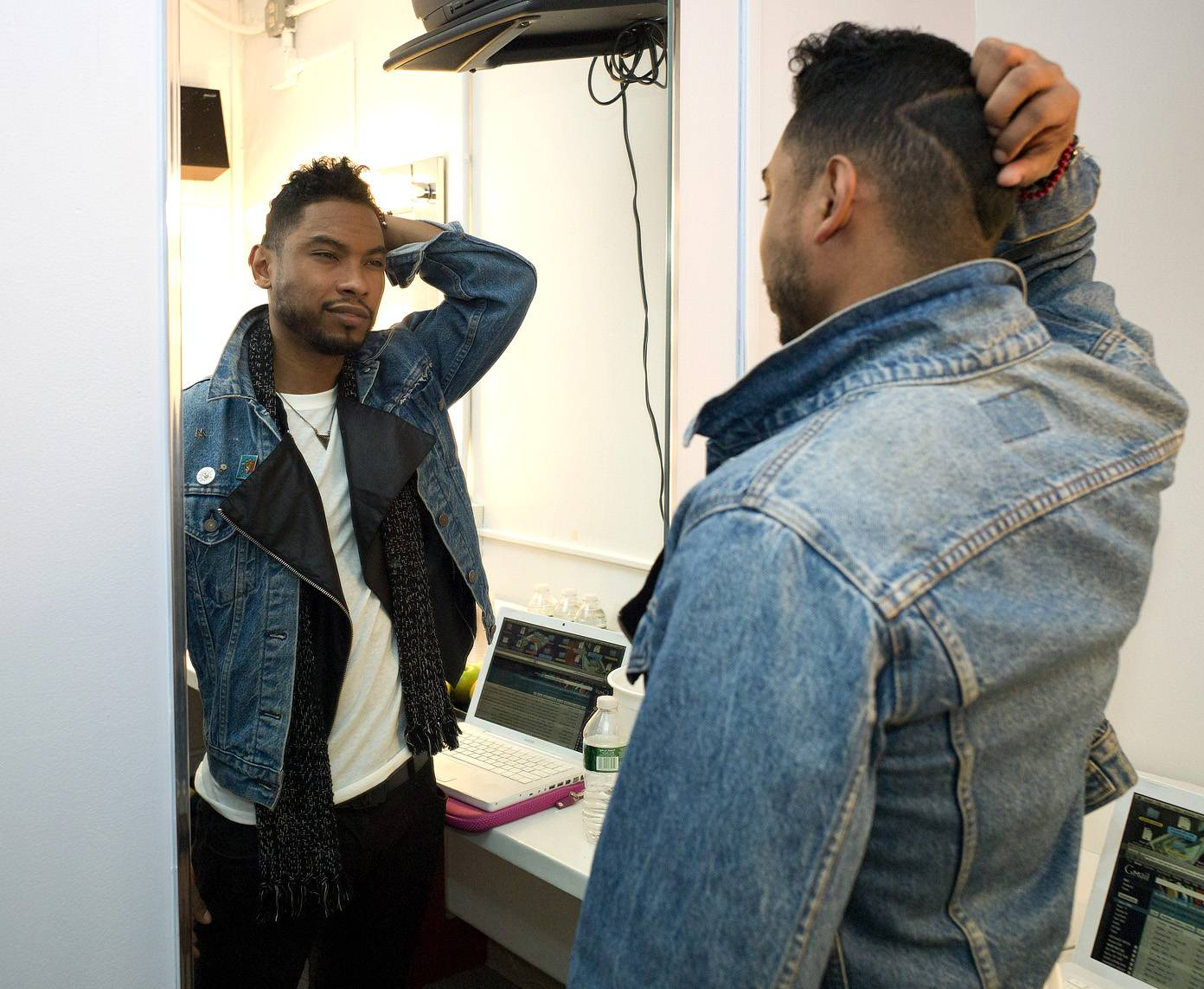 One Long Part For Cut Master Style - Miguel checks out the part by Cut Master Style backstage at BET Studios. (Photo: John Ricard / BET)