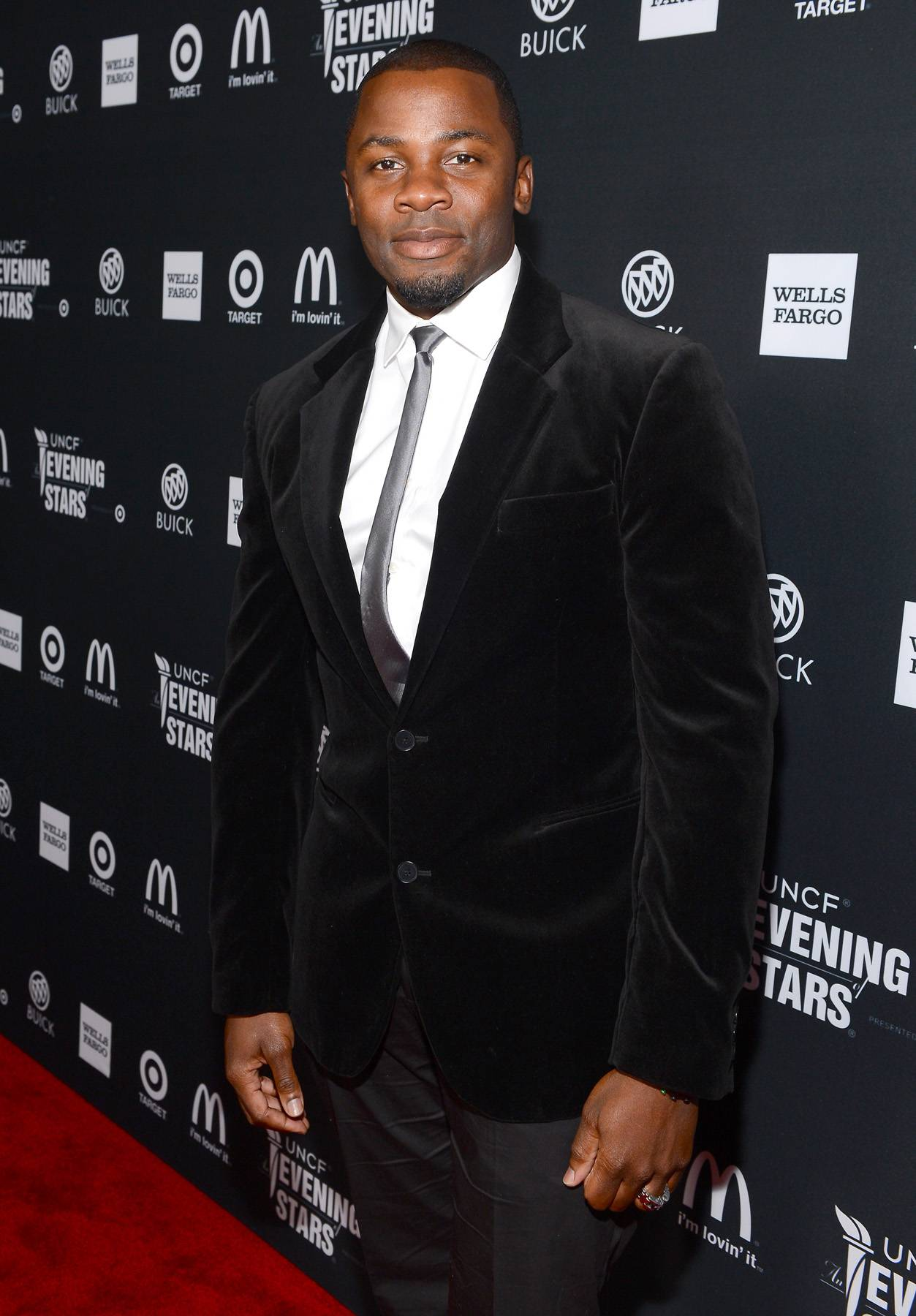 Take That, Take That! - Versatile actor Derek Luke walked the red carpet in a black suit highlighted by his skinny silver tie.  (Photo: Mark Davis/Getty Images for BET)