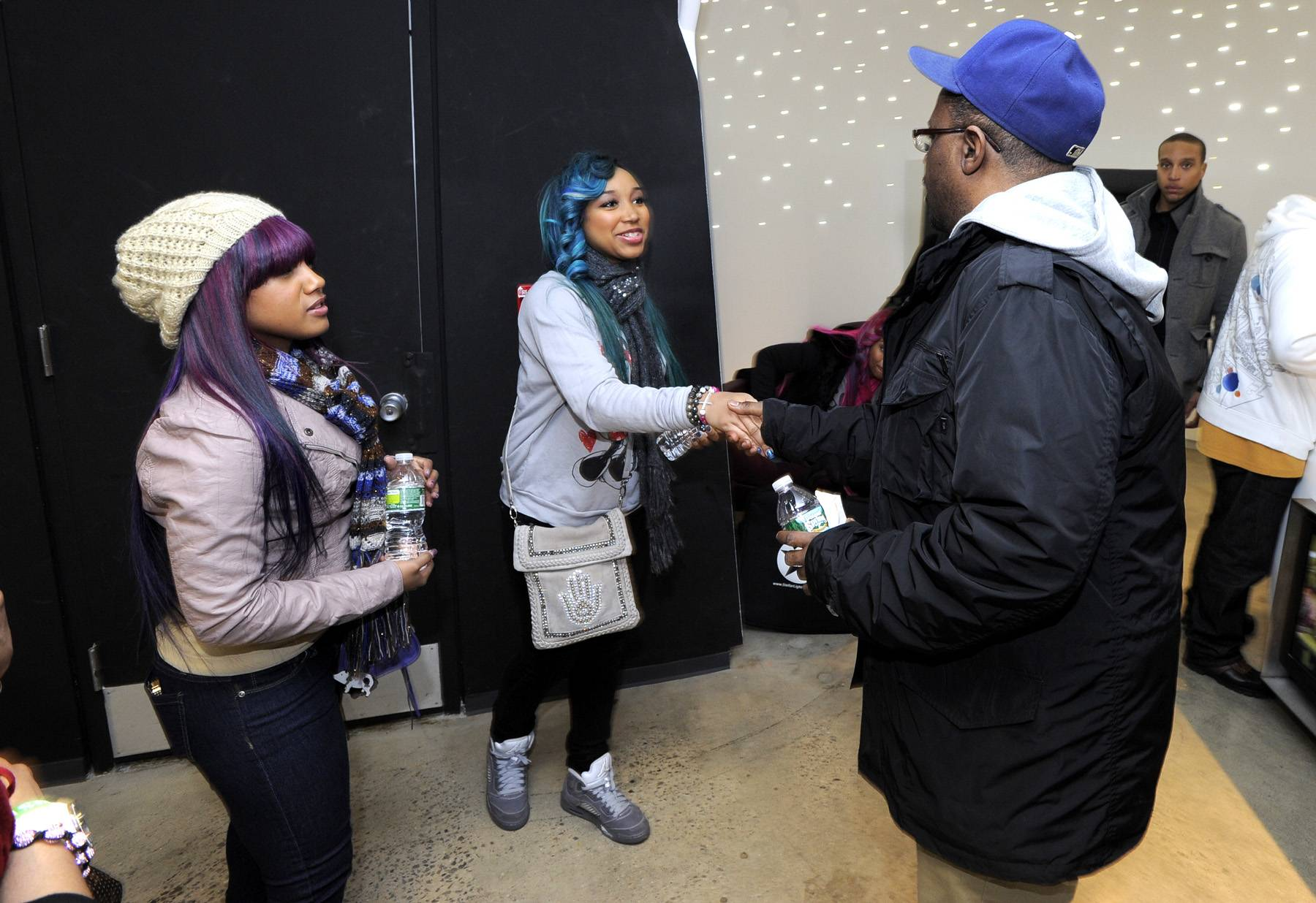 Pretty Girlz - Babydoll and Star shake hands with a BET staff member before an impromptu performance!(Photo: John Ricard / BET)
