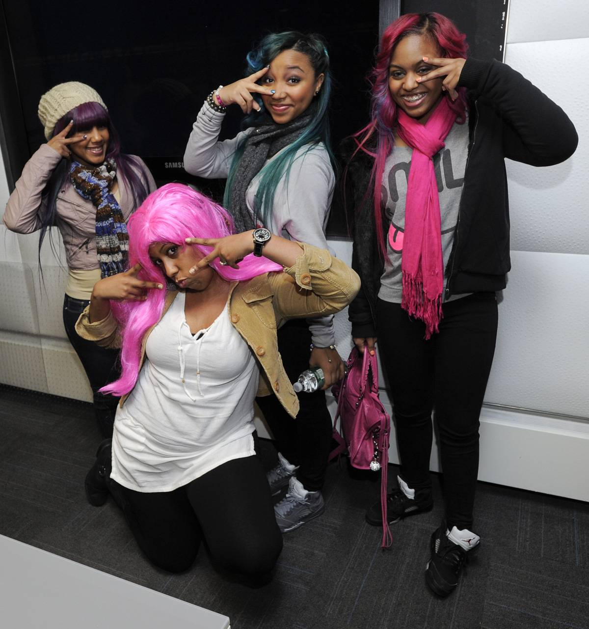 A New Member? - It looks like somebody wants to be the fourth member of the OMG Girlz, too bad all the slots are filled! Her neon pink wig is hot though!(Photo: John Ricard / BET)
