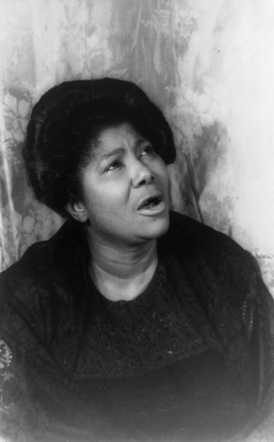 """""""Move On Up a Little Higher"""" - In 1948, Mahalia Jackson recorded William Herbet Brewsters' inspiring gospel song, ?Move On Up a Little Higher.? Mahalia?s rendition resonated with fans, and brought her unheard of mainstream success for a gospel artist. The record went on to sell eight million copies, and was later honored in the Grammy Hall of Fame Awards in 1998. Jackson began touring concert halls in the United States and Europe, bringing her powerful voice and message of faith to people around the world. Jackson found success in her record contract with Columbia Records.(Photo: Courtesy Library of Congress)"""