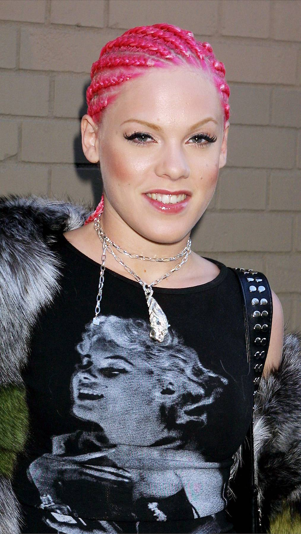 Pink on P!nk - P!nk's hair isn't pink anymore, but when she emerged as an artist, her hair was pink and at times braided in cornrows, like it is here. All we can say is that you live and you learn.(Photo: George De Sota/Newsmakers)