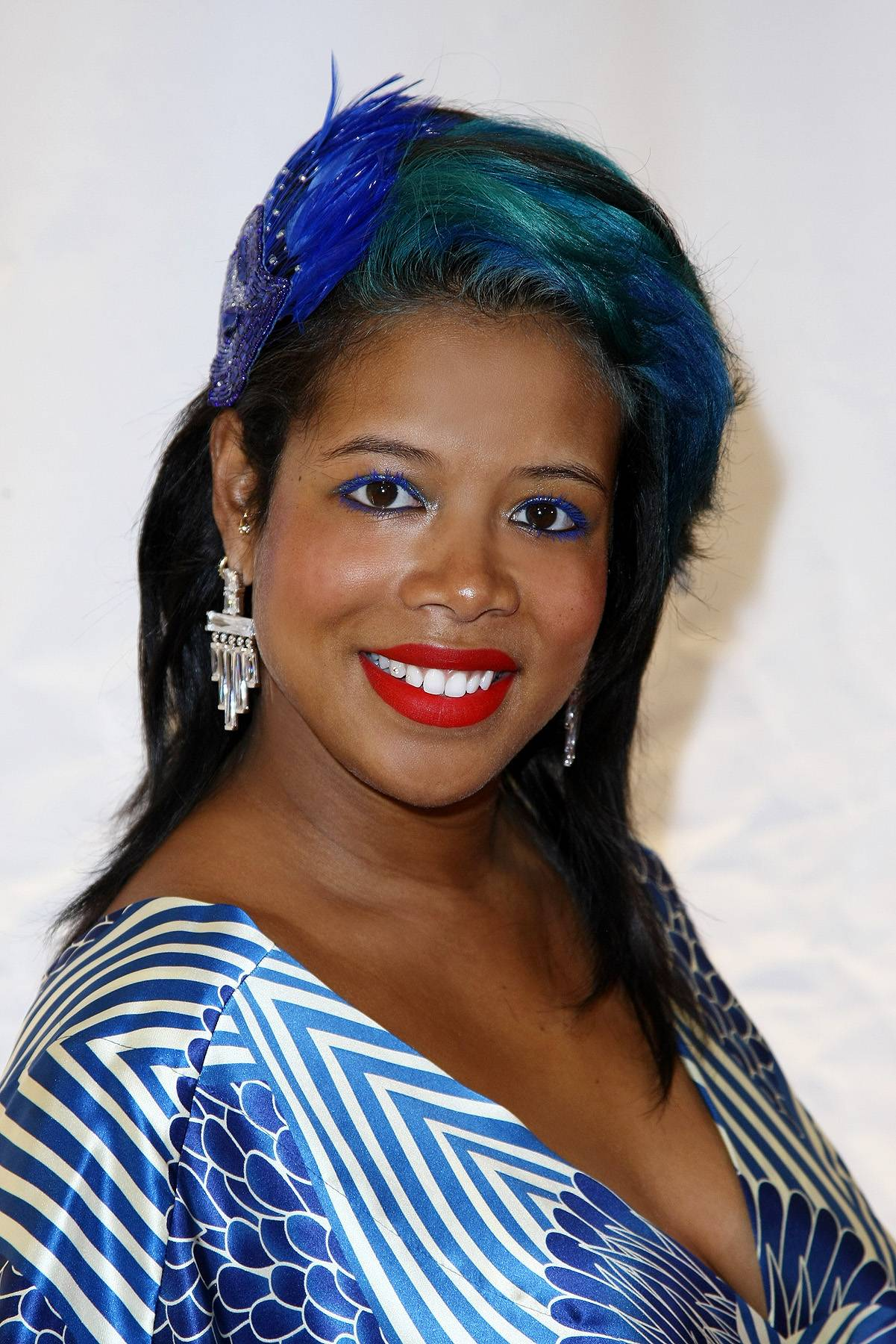 Moody Blue - Blue usually means that you're sad, but Kelis looks extremely happy with her blue and teal tresses.(Photo: Neilson Barnard/Getty Images)